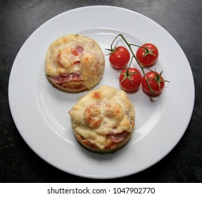 Crumpets (small griddle cakes) with houmous, honey glazed ham, vine tomatoes and a generous blanket of warm french cheese