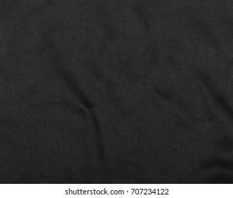 Crumpled black microfiber cloth background, texture