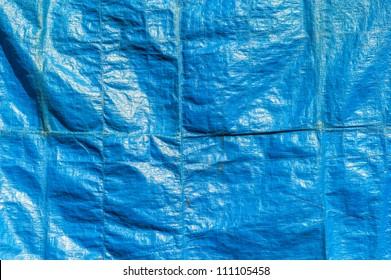 Crumpled blue textile surface