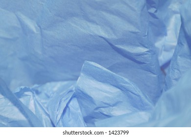 Crumpled blue tissue paper for a background or gift wrap for husband, father, boyfriend, son, or brother.