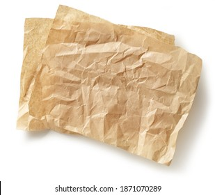 crumpled brown baking paper sheets isolated on white background, top view