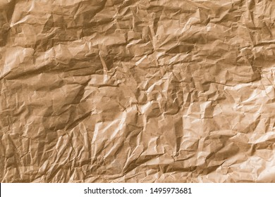 Crumpled brown kraft paper texture background.