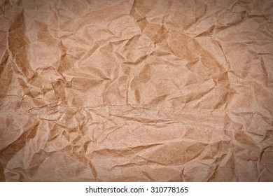 crumpled brown paper background or texture