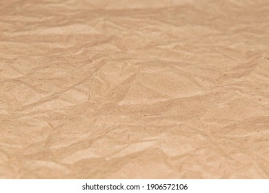 Crumpled brown wrapping paper. Background. Shallow depth of field