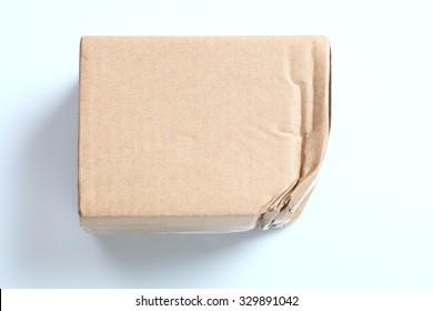 Crumpled cardboard box parcel