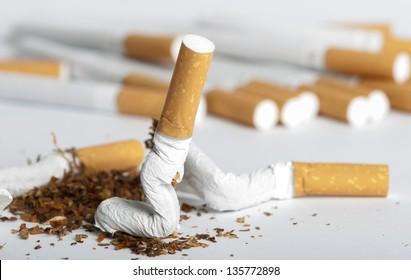 Crumpled cigarette. Shite isolated studio shot