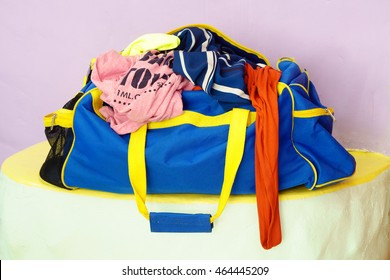 crumpled clothes in travel bag