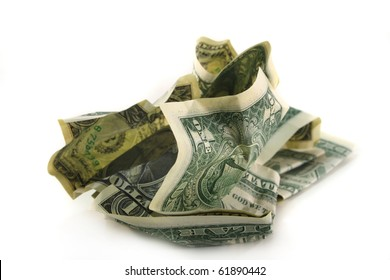 crumpled dollar bills in front of white background