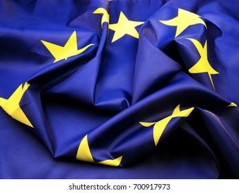 Crumpled European flag; background of ruffled silk EU flag