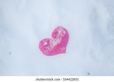Crumpled hearts on the snow