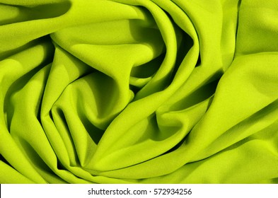 Crumpled neon green textured fabric.