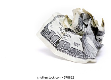 crumpled one hundred dollar bill, macro shot over white with focus on 100