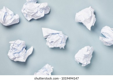 Crumpled paper ball isolated on blue background
