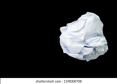 Crumpled paper ball isolated on a black background.