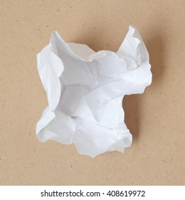 Crumpled paper ball on wood background