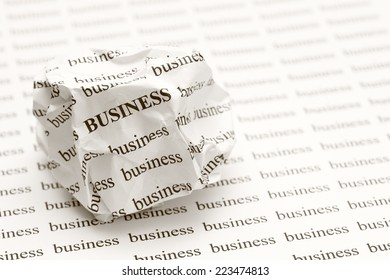 "Crumpled paper ball with words ""business"""