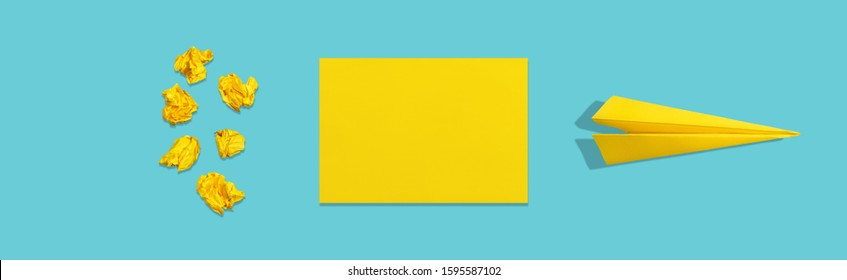 Crumpled paper, blank sheet and crafted plane on blue background. The concept of brainstorm and learning. Abstract creative image in minimalistic style.