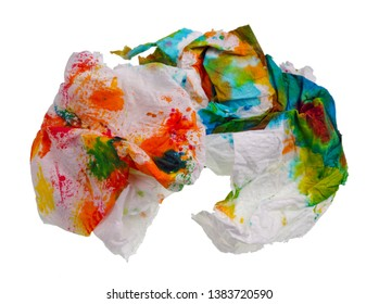 Crumpled paper broken  napkin wiped paint from Easter egg. Isolated on white ctudio macro