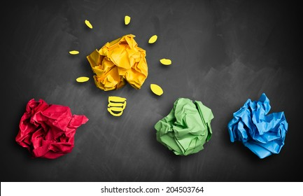 crumpled paper in different colors and one as an idea