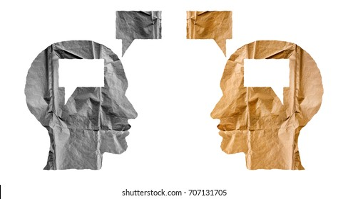 Crumpled paper shaped as a human heads and talk balloons on white background. Conversation, dialogue and opinion concept.