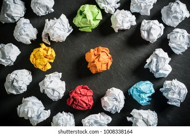 crumpled paper symbolizing different solutions with some standing out with a different color