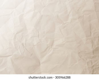 Crumpled paper texture pattern background in light brown color tone
