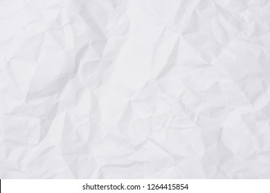 crumpled paper white paper background.