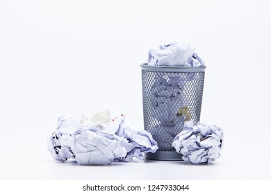 Crumpled Papers In Basket Over White Background
