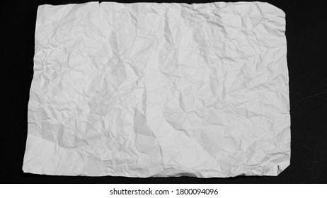 a crumpled piece of white paper