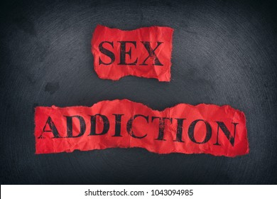 Crumpled pieces of paper with the words Sex Addiction. Close up.