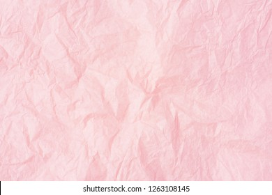 Crumpled pink paper or pink paper texture pattern background. Paper for interior and exterior decoration or background for handcrafts. Abstract rose paper background.