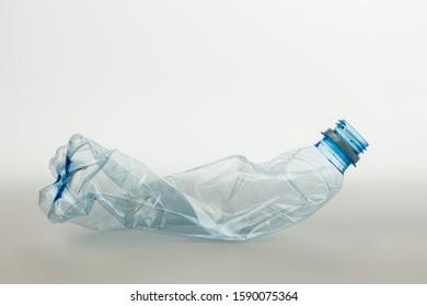 Crumpled plastic bottle. Grey isolate