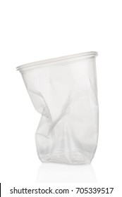 Crumpled plastic cup on white background