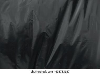 crumpled plastic film texture black garbage bag