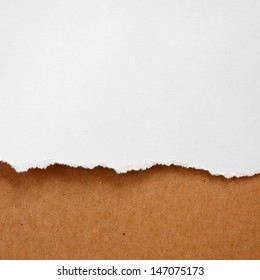 Crumpled ragged white paper isolated with brown board