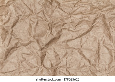 Crumpled recycled paper background texture. Vintage craft paper texture brown  color. Paper for package.
