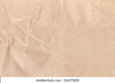 Crumpled recycled paper  texture or background. High resolution recycled brown cardstock with halftone