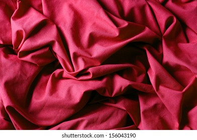 The crumpled red fabric