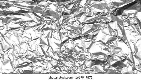 Crumpled silver foil texture. Abstract shiny background