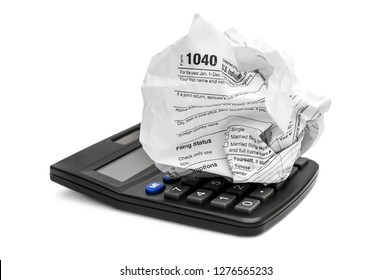 Crumpled tax form with calculator on white.