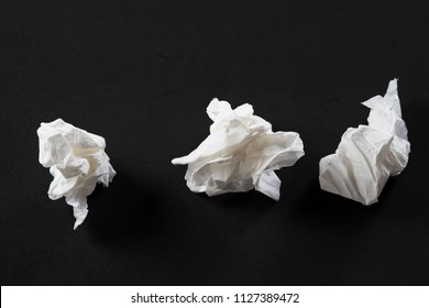 Crumpled tissue paper on black background texture