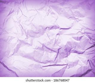 Crumpled violet paper texture background