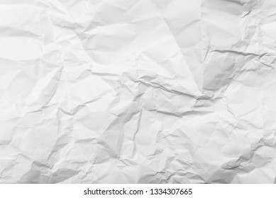 crumpled white paper background texture, close up.