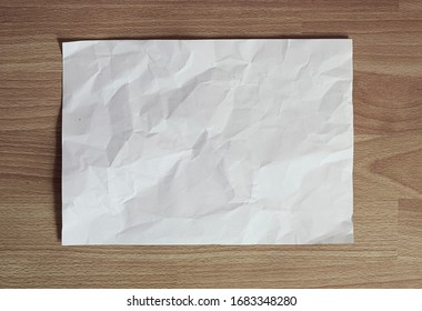 Crumpled white paper top view