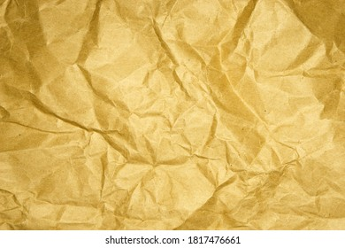 Crumpled yellow-brown eco paper. Recycled craft cardboard. Paper textures. Background.