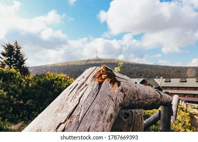 Crunched wooden fence frame in the foreground and in the background the dominant feature of the Jesenik Hruby - Praded lookout tower and television transmitter, lost in the clouds. Beautiful morning. - Shutterstock ID 1787669393