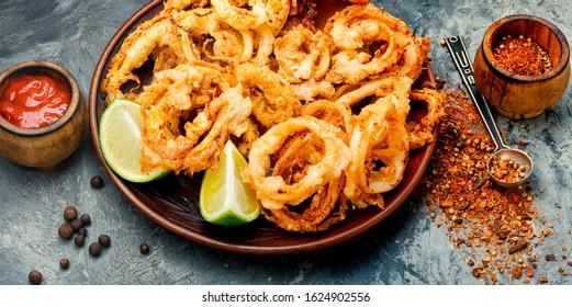 Crunchy deep fried squid rings in batter