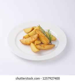 Crunchy fried potato slices with fresh rosemary isolated on white background