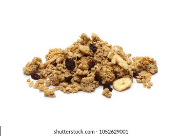 Crunchy granola, muesli pile with banana, pineapple slices, peanuts and raisins isolated on white background