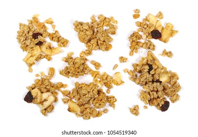 Crunchy granola, muesli pile with banana, pineapple slices, peanuts and raisins isolated on white background, top view